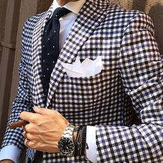 This gingham sport coat is a great pair with a nice navy European cut navy pant and tan shoes.