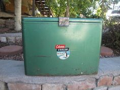 {1950s vintage coleman penguin 633 green metal cooler} destined to become a side table for a cabin, once i figure out a base to add a little height.