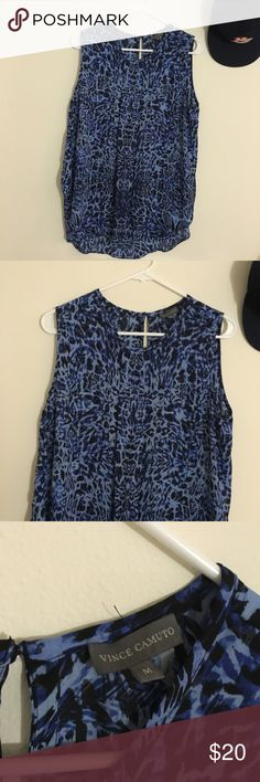 Vince  Camuto Leopard Print Tank Sleeveless  Curved hem  Hi Lo  Jewel neckline  Cut out on back  Blue animal print  100% Polyester   Size: Medium  Length: 28.5 Bust: 20in   Condition: Like New, No Damage  No Pets  Non smoking house Vince Camuto Tops Tank Tops