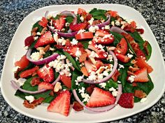 Strawberry Spinach Salad - spinach, bacon, tomatoes, feta cheese, almonds, red onions, and strawberries