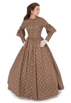 Recollections  Code: 141266  dress is made up in cotton fabric, and has a high neckline, long sleeves with a sweet flounce above the elbow, and a front button closure. The long skirt is full enough to accommodate a hoop if you like.