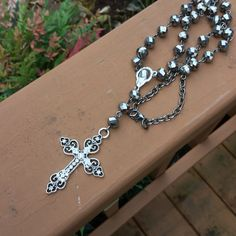 A personal favorite from my Etsy shop https://www.etsy.com/listing/486231255/black-crystal-rosary-necklace-gunmetal