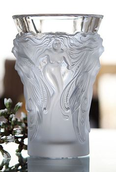 "Lalique Fantasia Vase  $995.00	H: 7"" 		  Item# 1262600  Shrouded in mist, four Venus with braids of pearls, emerge from the mist."
