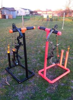 His & Her bow stands made from PVC pipe! Too awesome!