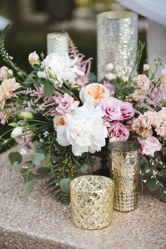Pretty centerpieces: http://www.stylemepretty.com/little-black-book-blog/2015/02/27/blush-gold-rosemary-beach-wedding/   Photography: Leslie Hollingsworth - http://www.leslie-hollingsworth.com/