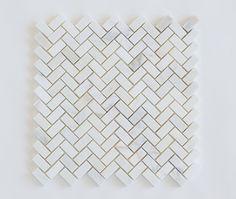 Floor & Decor  sweet marble mini herringbone tile for their kitchen backsplash