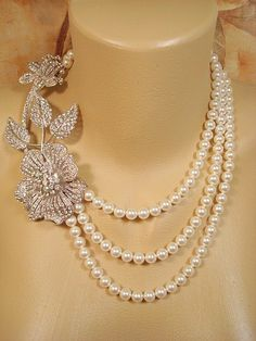 Bridal statement necklace, pearl necklace, wedding jewelry with Swarovski crystal pendant and Swarovski pearls, bridal jewelry. $135.00, via Etsy.