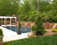 Raised bond beam on this pool acts as a retaining wall as well as having water features to dress up the pool.