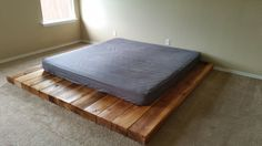 The Low Wooden Platform Bed would be ideal for use within an attic or loft space where ceiling height is low or for those who prefer a more 'oriental' or minimalist style. The low nature of this bed frame also helps to provide a spacious feeling to your bedroom. It is a simplistic, chunky, rustic, and solid bed frame. The width of the wood framing could be used for keeping a book, a glass of water, or anything else close at hand. The Low Wooden Platform Bed is created by hand using…
