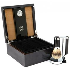 CARBON & HUMIDOR Our elegant gift box highlights the hand-woven carbon fiber in this sleek shave set. The box is created with luce grey veneer from Italy and anigré wood from Tanzania.