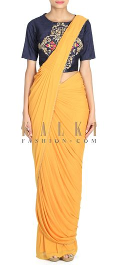 Buy this Mustard saree gown with pre stitched pallav only on Kalki