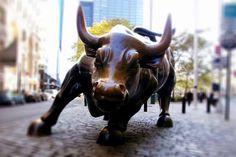 Charging Bull NYC by Artist Arturo Di Modica - The symbol of aggressive financial optimism and prosperity -