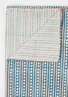 This hand-quilted blanketis not only beautiful but extremely soft and comfortable. The distinct diamond pattern is made from hand-blocked layers...
