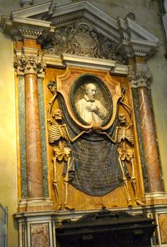 Interesting sculpture with skeletons on a tomb at St. Peter in Chains Cathedral, Rome, Italy