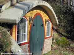 The owner of this Hobbit shed in New York writes: I needed a shed to put my lawn tractor in so I asked my wife if I could build a shed out back. Being that I'm a fan of Hobbit architecture I figured this would be my only chance to build something resembli Backyard Buildings, Backyard Sheds, Small Buildings, Garden Sheds, Garden Art, Play Houses, Bird Houses, Cool Sheds, Shed Of The Year
