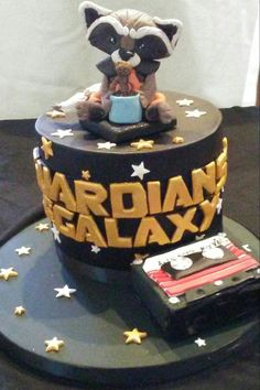 "Guardians of the galaxy cake. Fondant Rocket and baby Groot.  Mini cake cassette tape ""awesome mix vol.1"""