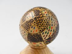 Birch ball, approx. 3 inches diameter, carved, wood burned, color added