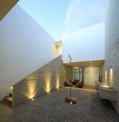 Inner courtyard at La Isla House, Lima, Peru by Llosa Cortegana Architects