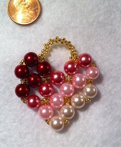 red-rose-pink pearl heart pendant #2  red, dark rose, pink & white pearl beads (8 mm), gold silver-lined seed beads (size 11); right angle weave stitch.