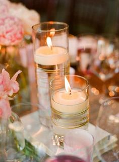 Embellish pillar vases by wrapping them with gold or silver twine, tie off with a tight knot and hide underneath a few layers. Add water and a floating candle.