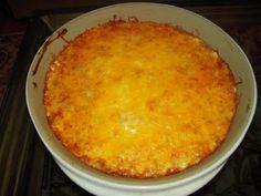 Easy mexican dip  Easy Mexican Dip  (Printable Recipe)    1 can refried beans (I use fat-free)  1 packet taco seasoning  8 oz sour cream  2 cups shredded cheddar cheese    Mix beans and taco seasoning. Spread beans in the bottom of a baking dish. Spread the sour cream on top of the beans and then top with cheese. Bake at 350 for 25-30 minutes - until cheese is bubbly. Serve with Fritos.