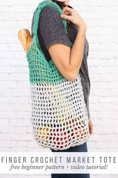 "This free market tote bag pattern and video tutorial is the perfect introduction on how to finger crochet! A speedy, satisfying project for adults and kids alike. Made using Lion Brand\'s Fast-Track yarn in ""Chopper Grey\"" and \""Go Kart Green. Free Crochet Bag, Crochet Market Bag, Crochet Shell Stitch, Crochet Tote, Crochet Purses, Lion Brand, Finger Crochet, Finger Knitting, Arm Knitting"