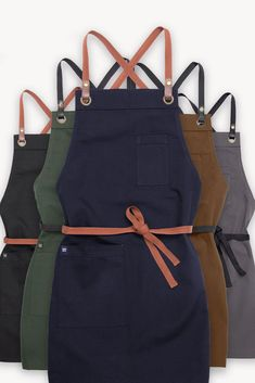 Our Tom Apron is a crowd favourite, and it has just gotten even better with the addition of its new 5th colour way - NAVY 💙 With quality hardware detailing, edgy shorter length, and pockets in all the right places, if you're looking for the perfect team apron you just can't go wrong with Tom⭐️ | Aprons | Work Uniform | Built for Work | Cargo Crew | Coffee Shop Style Work Uniforms, Apron Designs, Aprons, Webtoon, Coffee Shop, Fashion Forward, Crowd, Going Out, Toms
