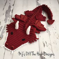 This is a PDF crochet pattern for a soft bulky Dragon blanket! Perfect to cozy up with on the couch. I designed this blanket for the dragon lovers out there!! It is designed to cocoon only around the calves and feet, the rest of the blanket opens up and lays across the body. Like my other blankets I've designed this pattern to work up quick. This blanket has more detail but I've included lots of photo illustrations and detail to help you. The body of the blanket uses 2 strands of bulky…