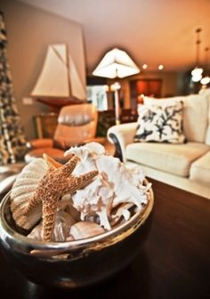 beach decorating style with shells and boats in a cream living room
