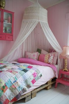 Sweet girly yet boho pink room full of pillows and comfy, clean, vintage linens.