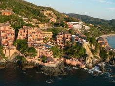 "On the Pacific Coast, La Casa Que Canta is perched on a cliff surrounded by the Sea of Zihuatanejo Bay - the ""Mexican Riviera"", with a magnificent panoramic view."