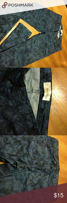 Denim floral design skinny jeans. Size 9 Almost new, only worn once.  Very cute! Rewind   Jeans Skinny