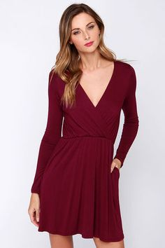 And just like that, the Alakazam Burgundy Long Sleeve Dress can transform your look into something magical! This pretty jersey knit number holds a soft and stretchy construction through long fitted sleeves, and a flattering surplice bodice with elasticized waist. A full skirt puts the finishing touches on this classic dress! Skirt is lined. 95% Rayon, 5% Spandex. Hand Wash Cold. Made With Love in the U.S.A.