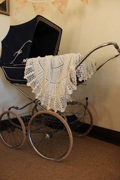 vintage pram with crochet lace blanket