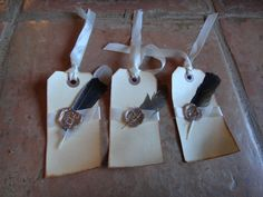 Feather with Hot Wax Crown Seal Gift tag Set with White Satin Ribbon.