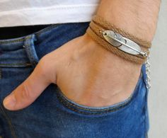 Looking for a gift for your man? Youve found the perfect item for this! The simple and beautiful bracelet combines brown fabric which wrap 3 times on