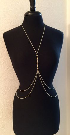This sweet and simple, yet super chic body chain is perfect for any occasion from the beach to nightlife! Perfect over a fitted cocktail dress, or wear it under a crop top! These body chains are very easy to put on and take off, with one small clasp at the lower back. Double layering chains on the bottom and a row of Swarovski crystals make this piece one of a kind!! *If you choose for 2 colors, please comment on your purchase, which order you want for the colors.   XS: 0-2 S: 2-4 M: 4-6 L…