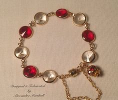 Enjoy or valentine gift this red and clear Swarovski Crystal Rivoli link and Siam crystal charm bracelet  by Alexandra Marshall. Magnetic clasp with safety chain. $49. Item #2095. Double click photo to order.
