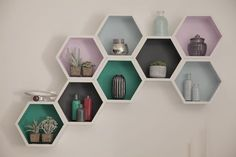 Hexagon shelves can make a really interesting feature on a wall (especially when combined with some unique painting effects). To shop the rest of our Let's Create with Colour ad and for more inspiration just check out the other pins on our board. FROM BnQ Living Room Paint, Living Room Decor, Living Rooms, Pentagon Design, Hexagon Shelves, Honeycomb Shelves, Geometric Shelves, Diy Wall Painting, Interior Painting