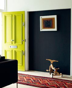 Yellow front door via July 2013 Elle Decoration