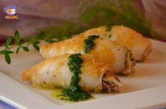calamari ripieni al forno, un secondo piatto gustoso e di facile realizzazione, a base di pesce. La cottura al forno permette di non eccedere con i grassi.