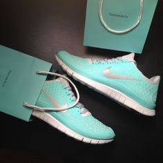 Light blue Nike tennis shoes. This is one of my favorite colors. Do you like? You should. These shoes are amazing!