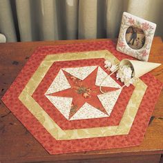 Quilt by Kaye Wood.Size: 15' x 17'Kaye Wood's Hexagon Star project is perfect for beginners since there are no points to match.  The center of the star is a perfect place to feature a large fabric motif such as the flower on the star shown in this slide.