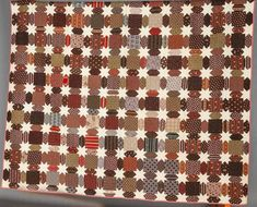 "All hand sewn, white muslin stars & calico blocks in shades of brown & red, 74"" x 84"", excellent.   $750"
