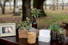 mason jars, peanuts, southern wedding, wedding decor ideas, succulents, glass bottles, framed photos, charming atmosphere, wedding photography :: James + Elena's Wedding at The Sam Davis Home in Smyrna, TN :: with Christine