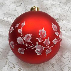 This vibrant red ornament is over-sized with a flowing floral design and would look great at the bottom of a large tree or as an accent decoration all by itself! Painted with Texture. Measures 4 1/2 x 4 1/2 Has my signature M at the bottom of the ornament.