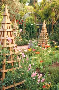 Trellis obelisks add vertical interest, form focal points in a border and provide a framework for plants to climb. Use them as a support for low-growing, climbing and vining plants in a vegetable or rose garden. Obelisks can be made from branches, wattle, bamboo, vines and wood.