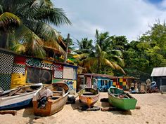 Photo: Colorful boats and buildings on a beach