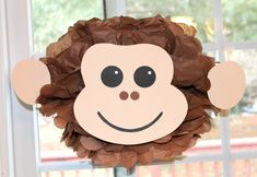Monkey pom pom kit king of the jungle safari noahs ark carnival circus baby shower first birthday party decoration. $9.99, via Etsy.