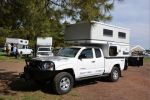 Short reviews of different slide-in pop-up truck campers from truckcampermagazine.com.